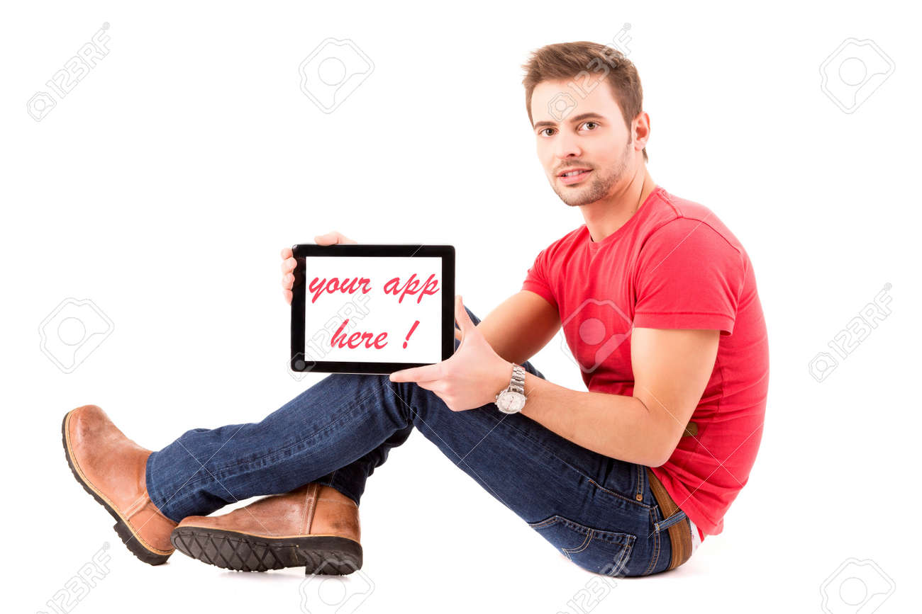 Happy young man presenting your product in a tablet computer Stock Photo - 18185460