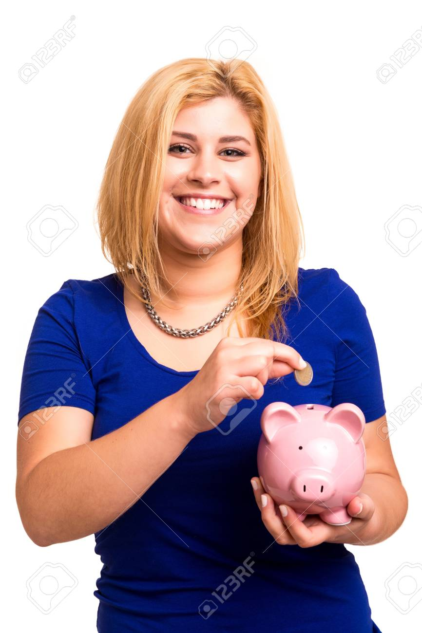 Young woman holding a piggy bank (money box) - savings concept Stock Photo - 20221759