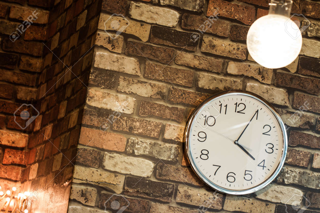Hanging clock on wall hanging clock on the wall stock photo picture and royalty free amipublicfo Gallery