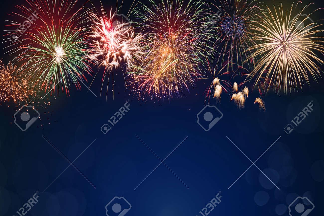 colorful fireworks on dark blue bokeh background, celebration concept - 130186565