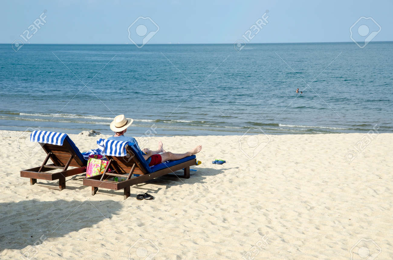 guy relaxing at the beach stock photo picture and royalty free