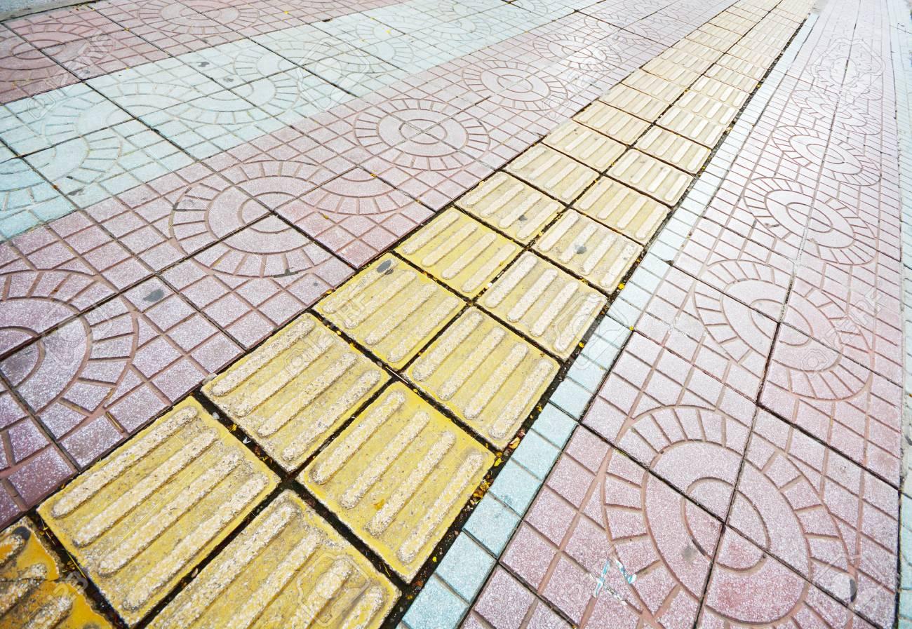 Tactile paving for blind handicap on tiles pathway stock photo tactile paving for blind handicap on tiles pathway stock photo 88677318 dailygadgetfo Choice Image