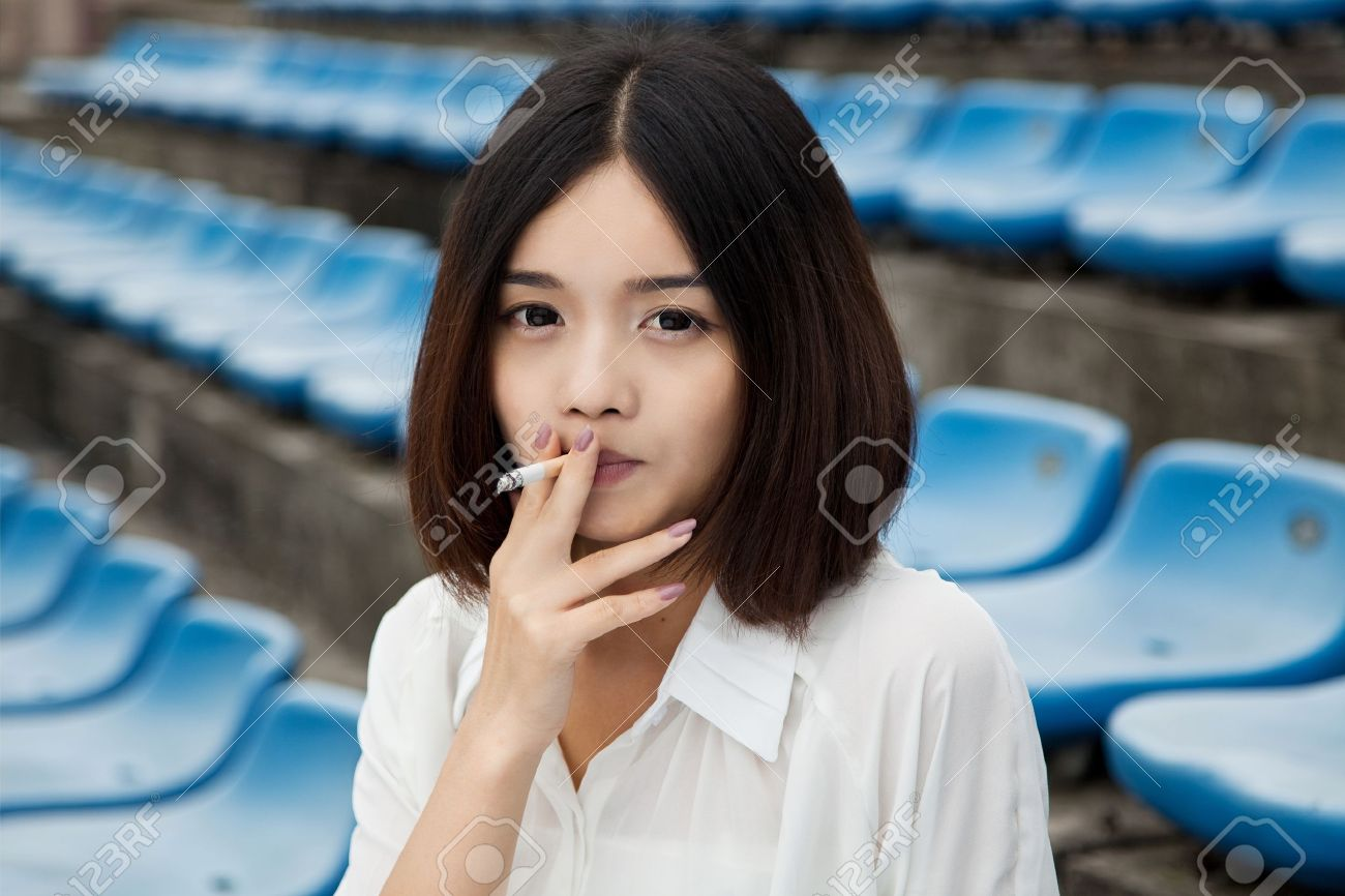 http://previews.123rf.com/images/humannet/humannet1209/humannet120900943/15455935-asian-female-smoking-Stock-Photo.jpg