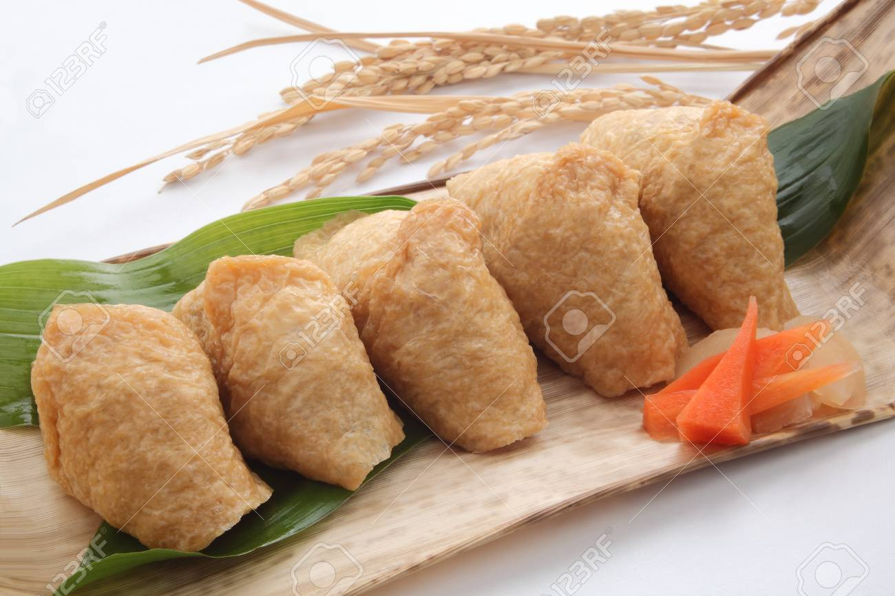 Inari Sushi Wrapped In Fried Tofu On Bamboo Sheath For Lunch
