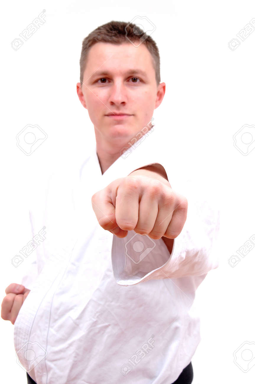 punch shock figure in the karate fighting stance on a white background hand-to-hand fighting Stock Photo - 16305415