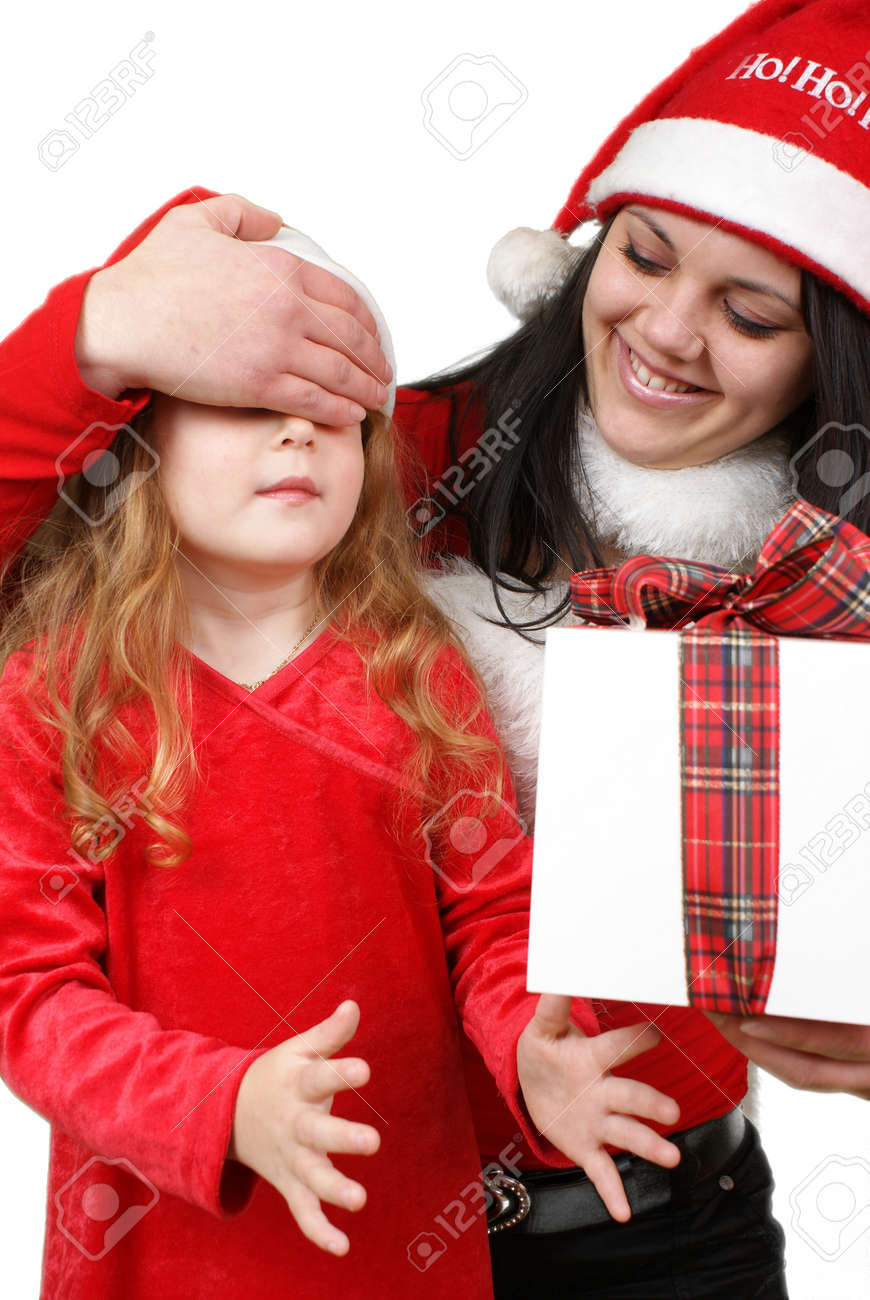 Little girl friend gives a holiday gift in red box with white ribbon. Stock Photo - 16305535