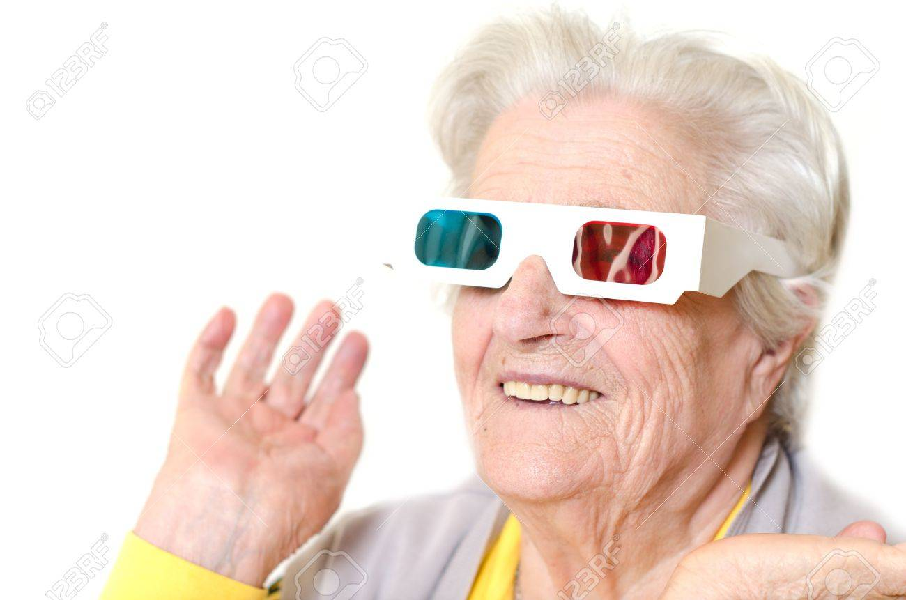 Senior woman wearing 3d glasses isolated on white background Stock Photo - 16305566