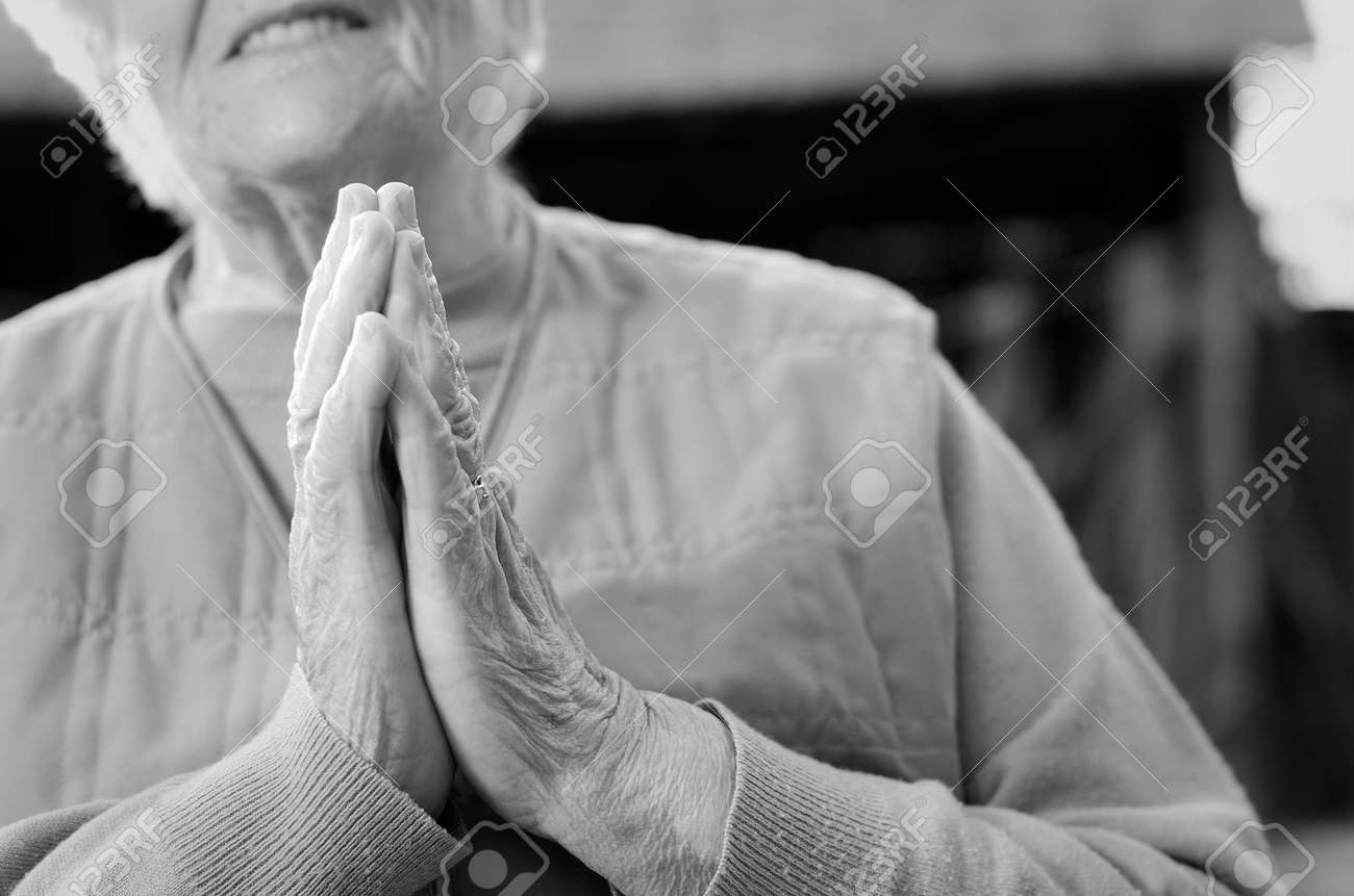 Senior woman holding her hands together Stock Photo - 20464545