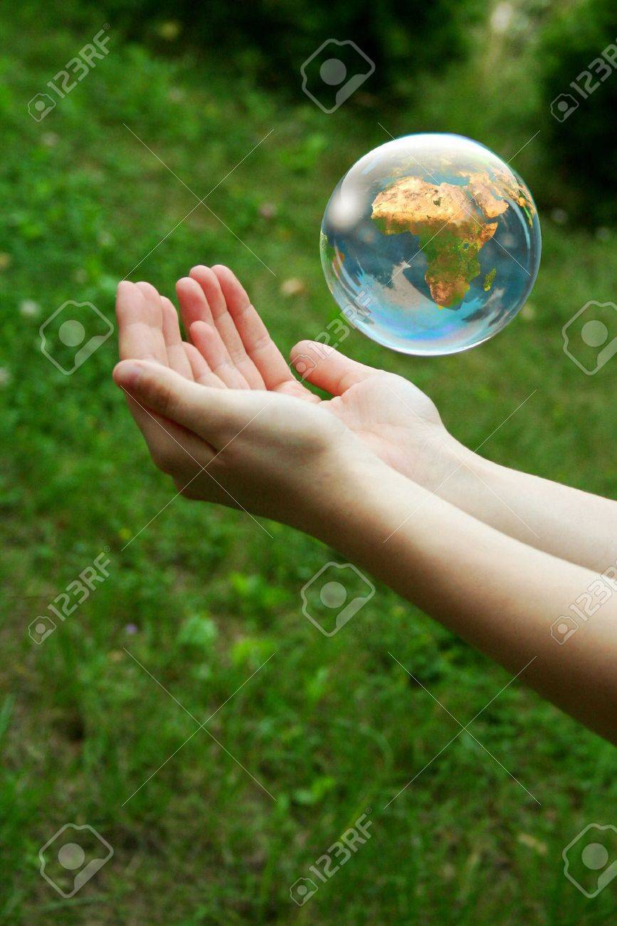 A globe above the women hand. Stock Photo - 11025017