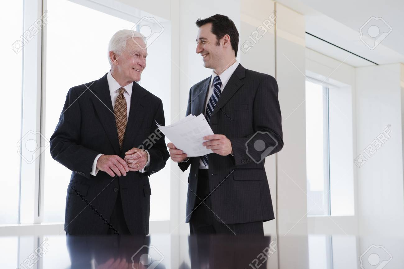 View of businesspeople discussing in an office. Stock Photo - 5579446