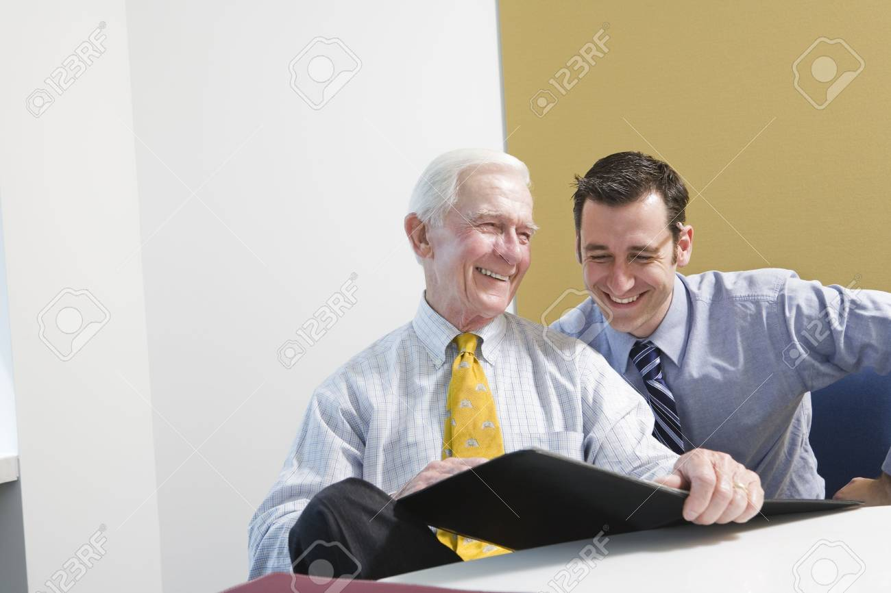 Businesspeople smiling in an office meeting. Stock Photo - 5579451