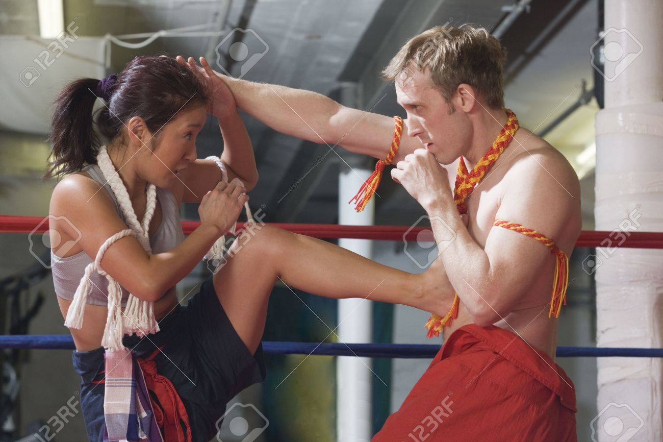 Man and woman in oriental Wei Kru martial art exercise with kick. Stock Photo - 5975766