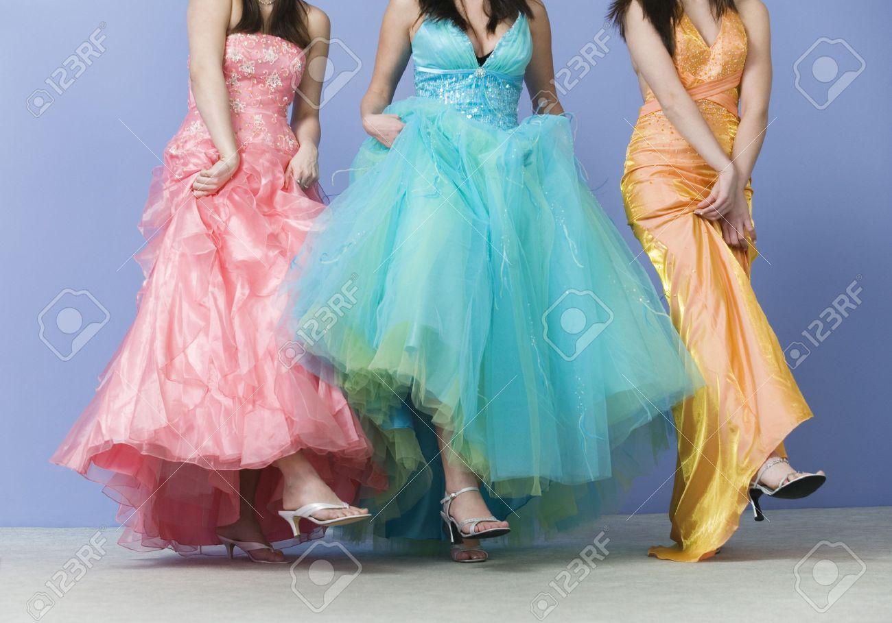 View Of Friends Dancing Wearing Prom Dresses. Stock Photo, Picture ...