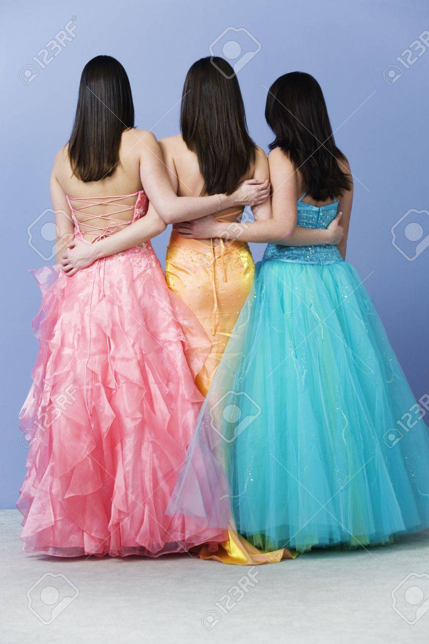 View of friends holding  each other by the waist wearing prom dresses. Stock Photo - 6144070