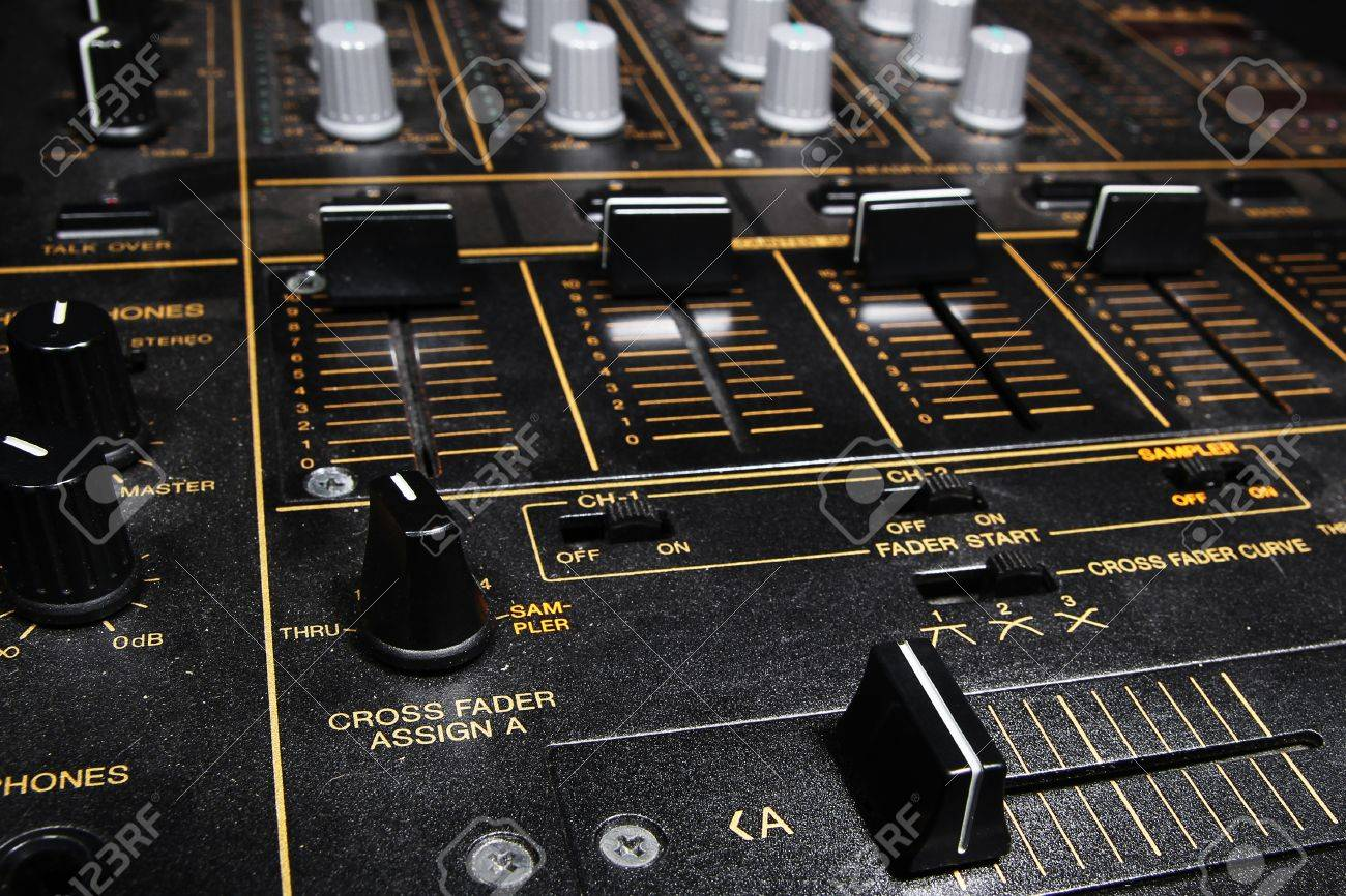 Professional djying equipment in the dark - 4channel club sound mixer Stock Photo - 10325554