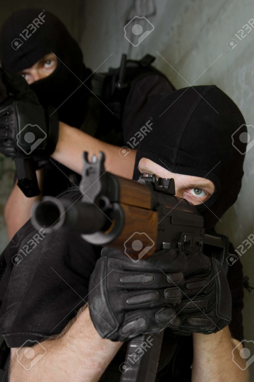 Photo of armed men in combat uniform playing terrorist or special forces team members Stock Photo - 10503671