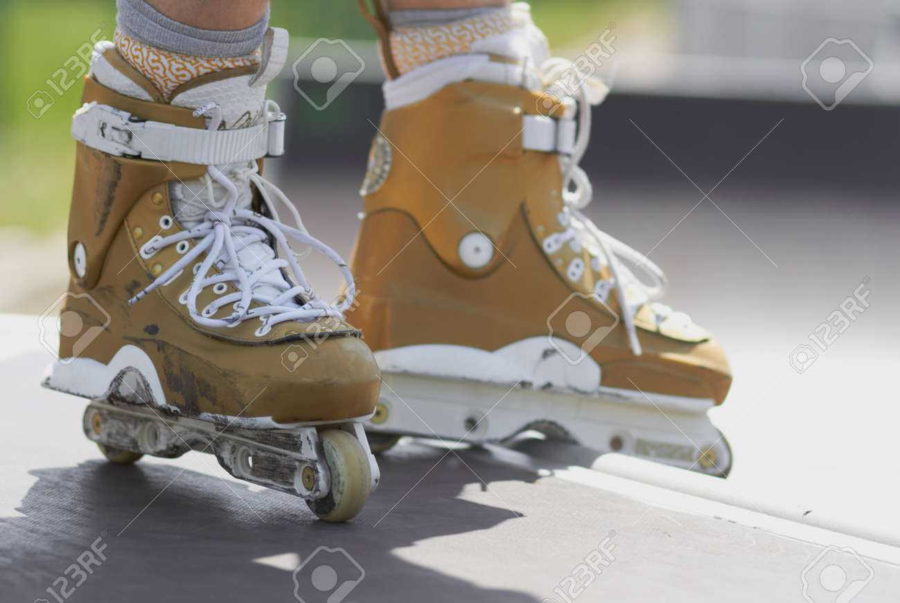 Legs of inline skater wearing professional aggressive roller