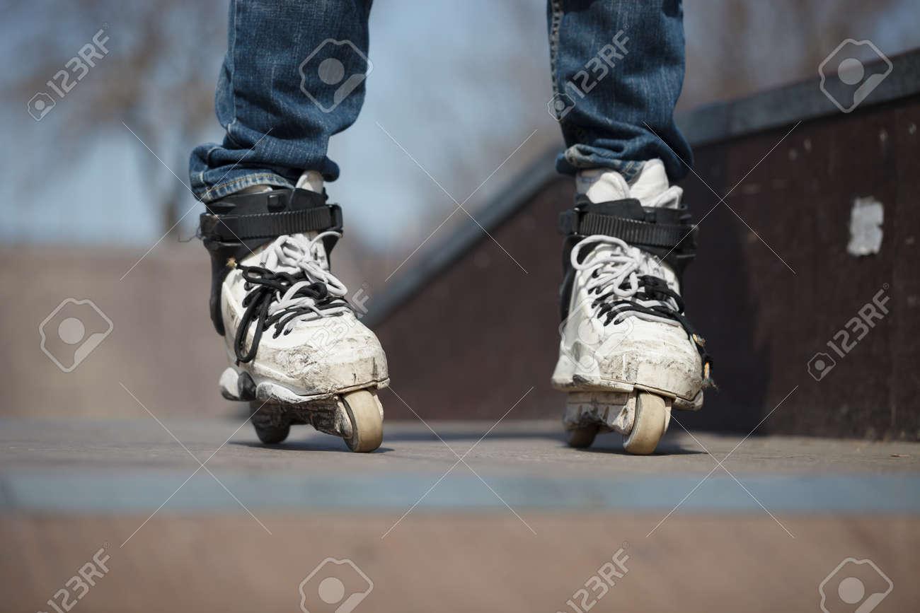rollerskater in skatepark wearing professional extreme inline