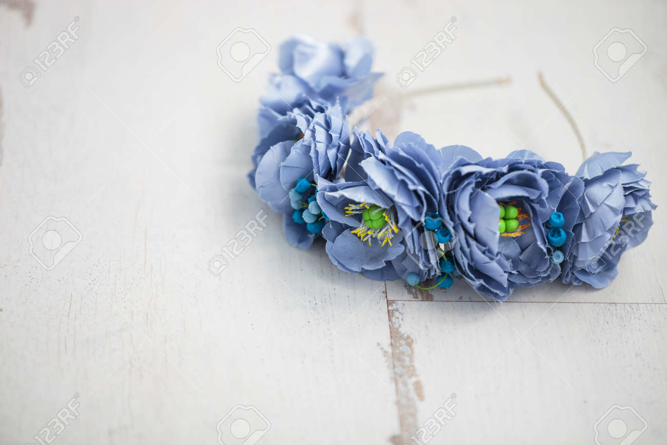 Handmade Wraith Made Of Artificial Blue Flowers Lying On The Stock
