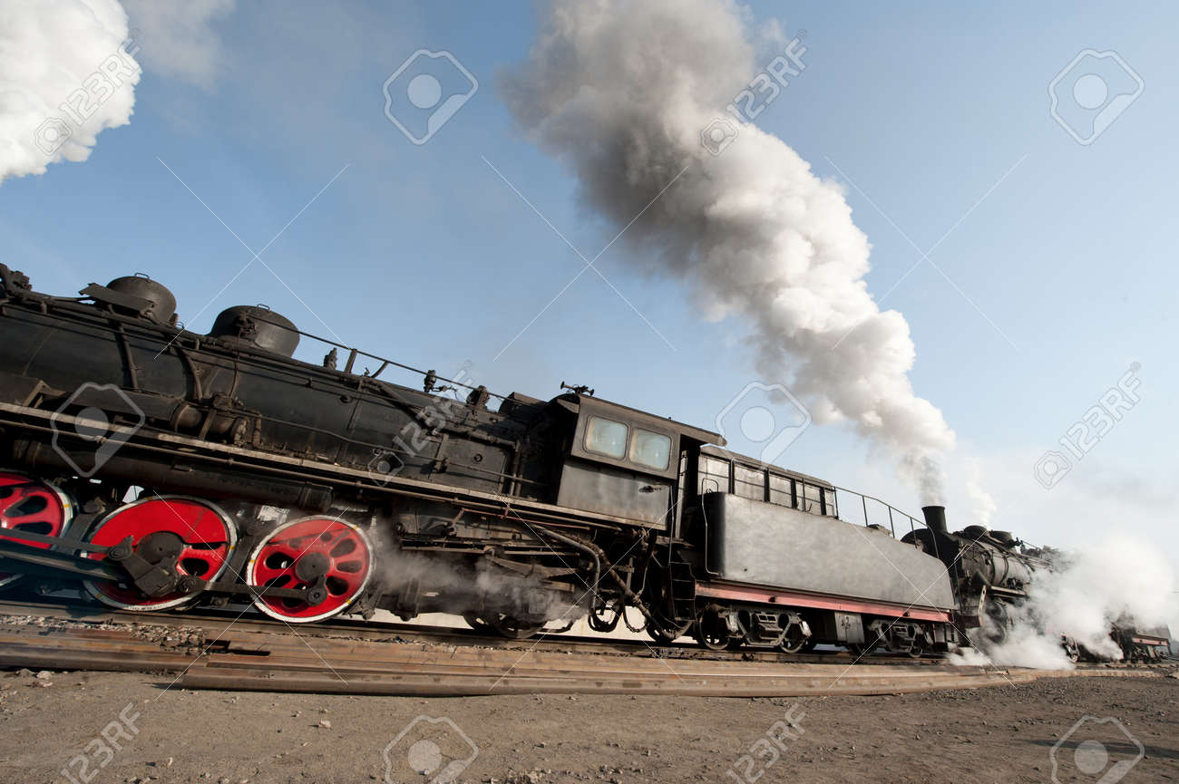 An Old Fashioned Steam Engine and Train Stock Photo - 18123029