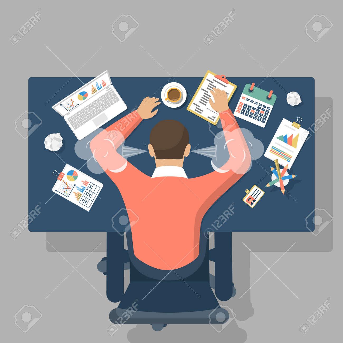 man at desk overwhelmed hard work stress at work fatigue at work