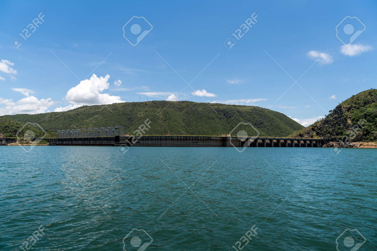 View from behind the floodgates of an electric power dam - 119223611