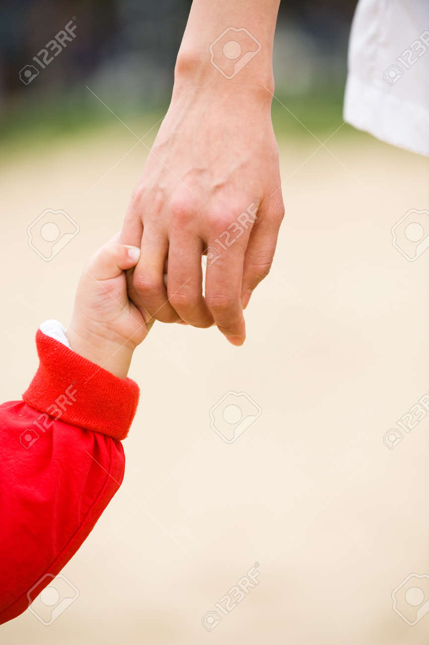 Baby reaching up to hold on to father Stock Photo - 11933756