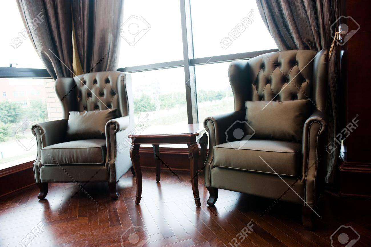 Two chairs and table in classic living room. Stock Photo - 13236834