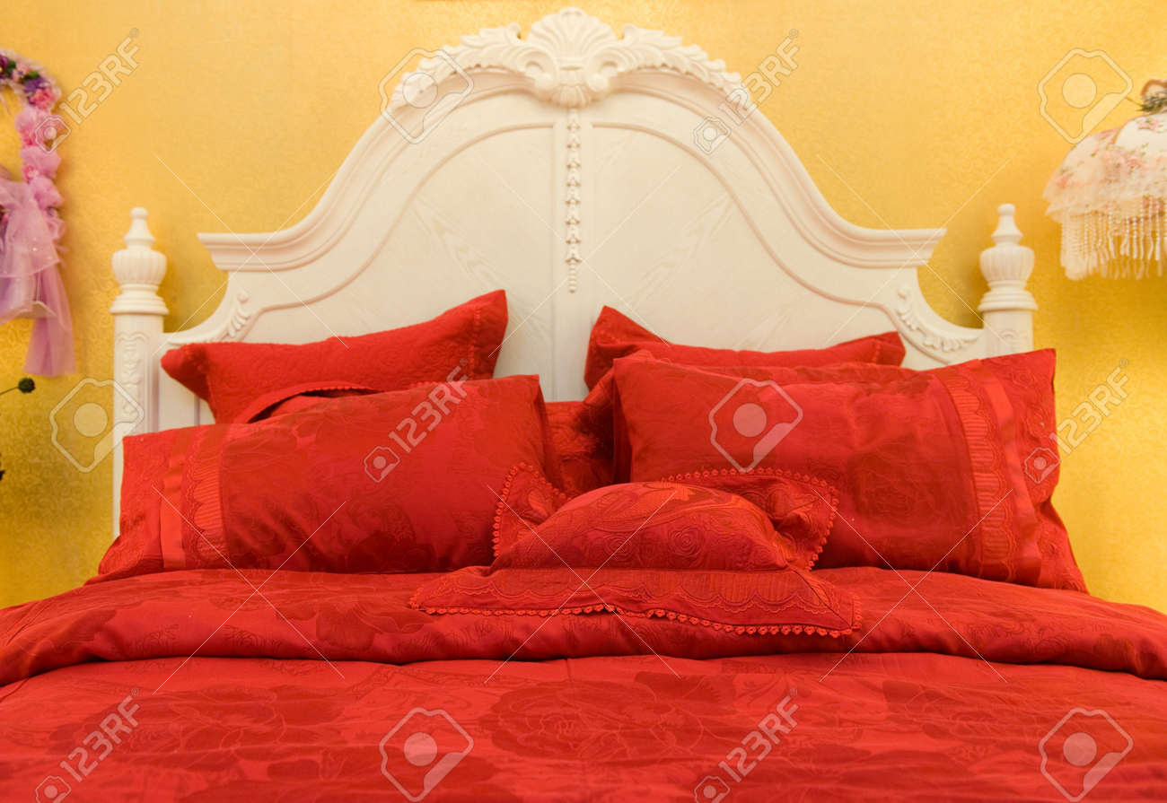 Double bed with pillows in red color. Stock Photo - 13237022