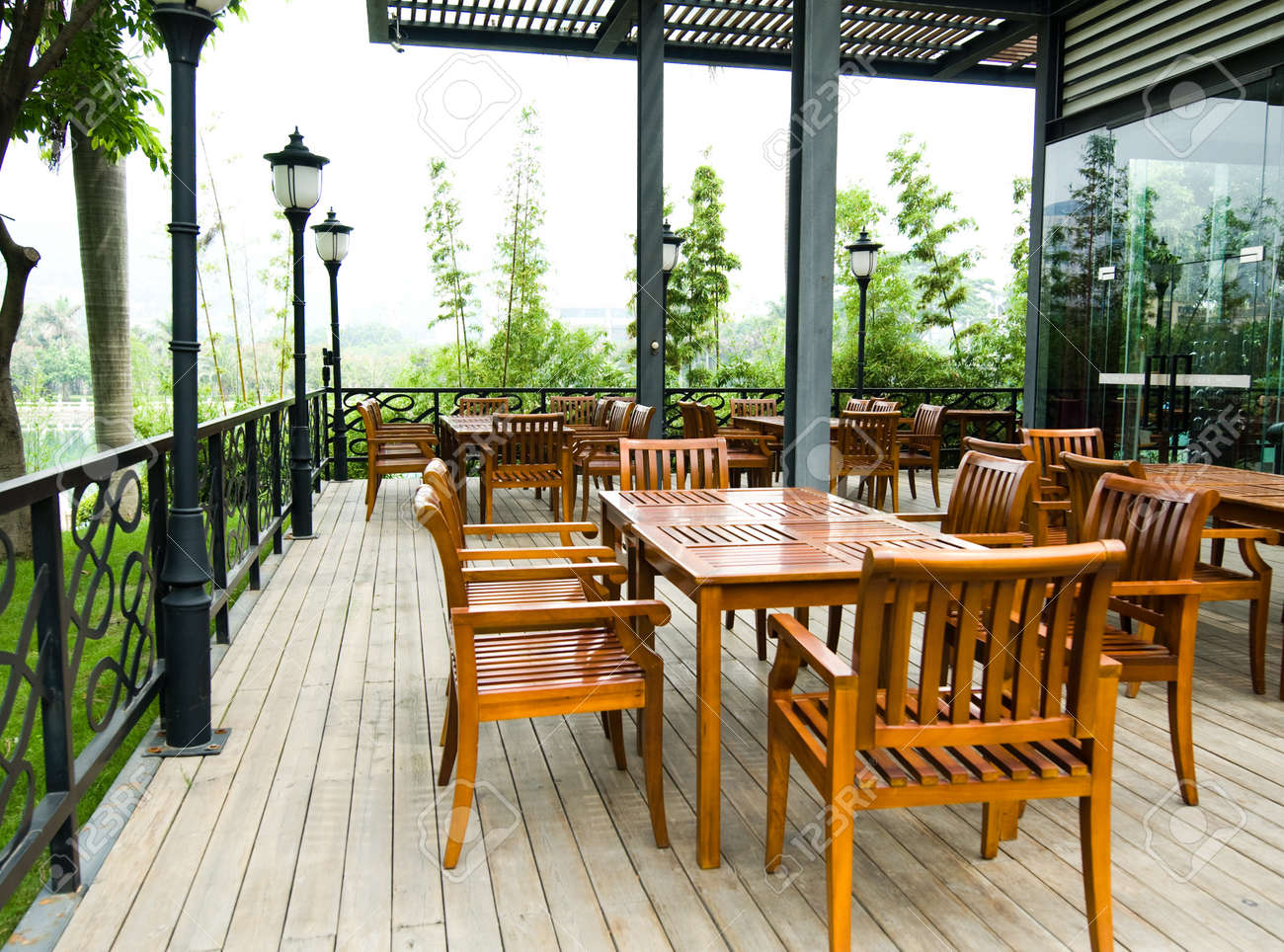 house patio with wooden patio furniture stock photo