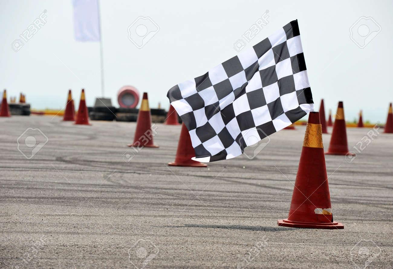 checkered race flag standing on floor. Stock Photo - 13344675