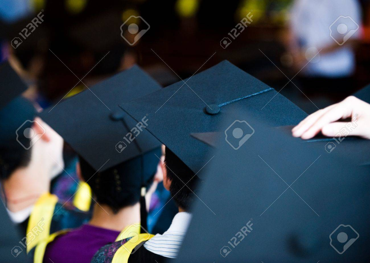 Shot of graduation caps during commencement. Stock Photo - 13448113