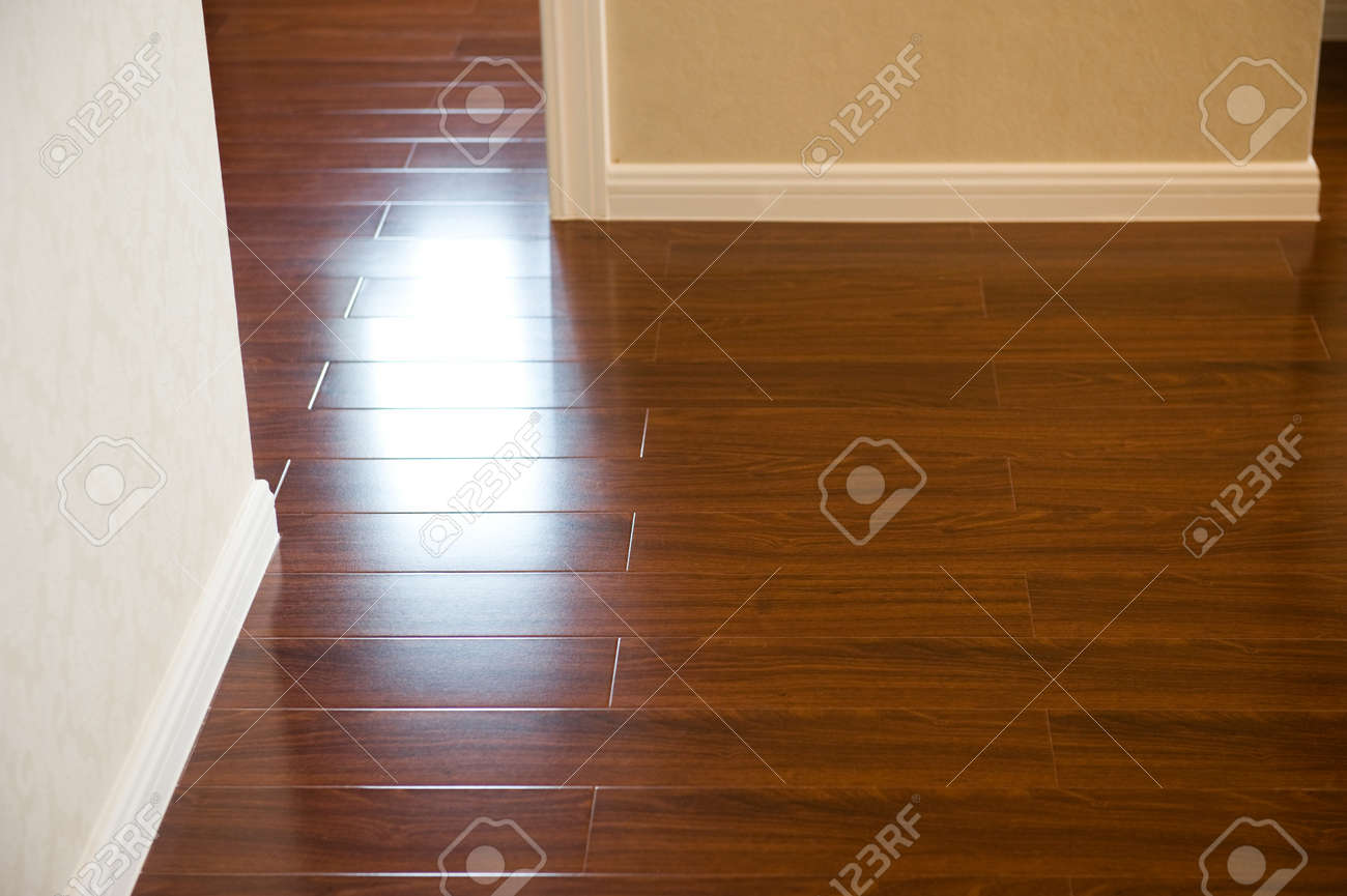 Skirting Board Corner Of An Empty Room With Wooden Floor Boards