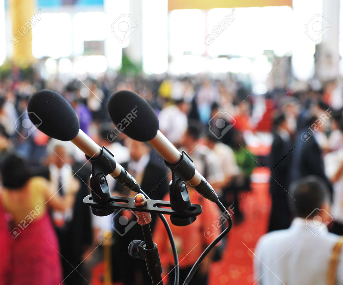 Closeup microphone in auditorium with people. Stock Photo - 13602268