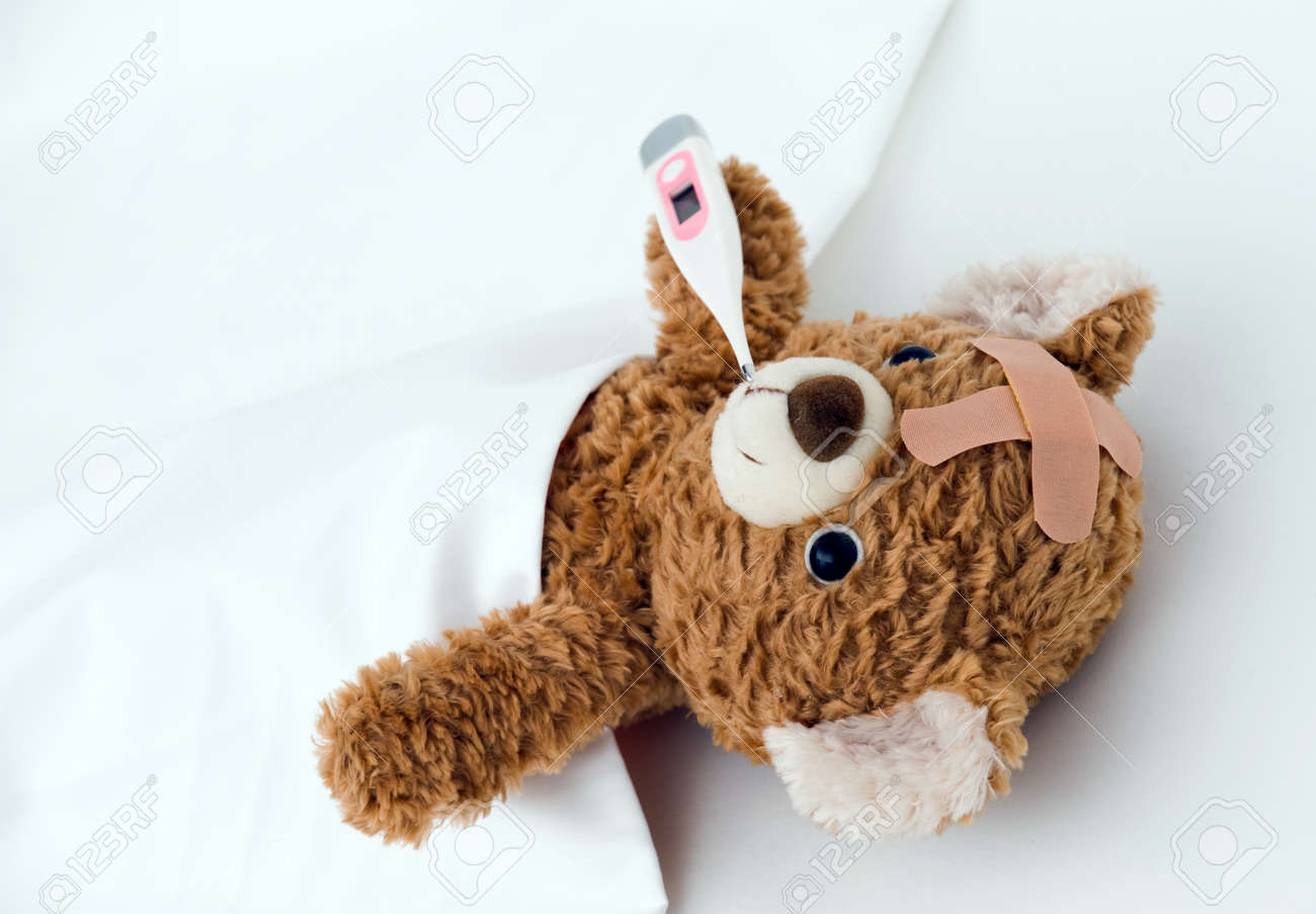 teddy bear ill in bed stock photo picture and royalty free image