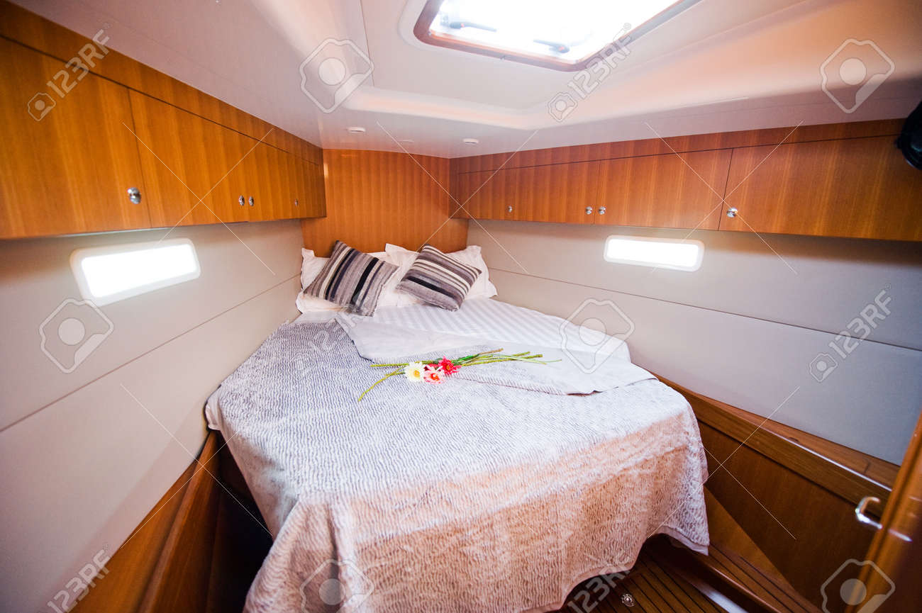 Inside Luxury Bedrooms bedroom inside a luxury yacht. stock photo, picture and royalty