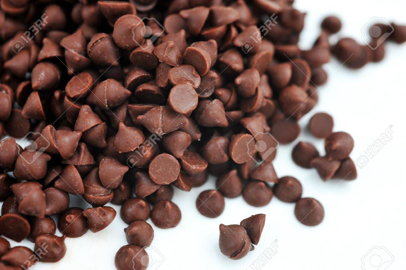 Dark chocolate chips on a white background. Stock Photo - 13780307