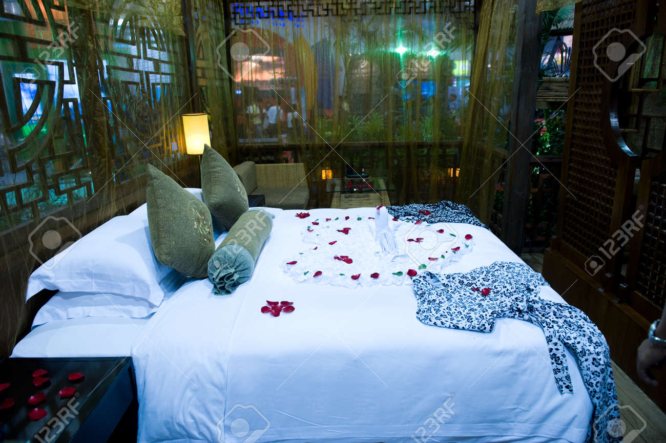 Honeymoon Bed Topped With Rose Petals Stock Photo Picture And Royalty Free Image Image 13861083