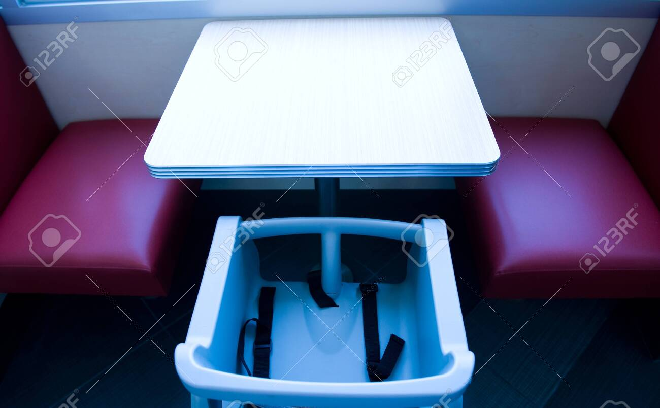 Baby eating chair in a restaurant. Stock Photo - 13829823