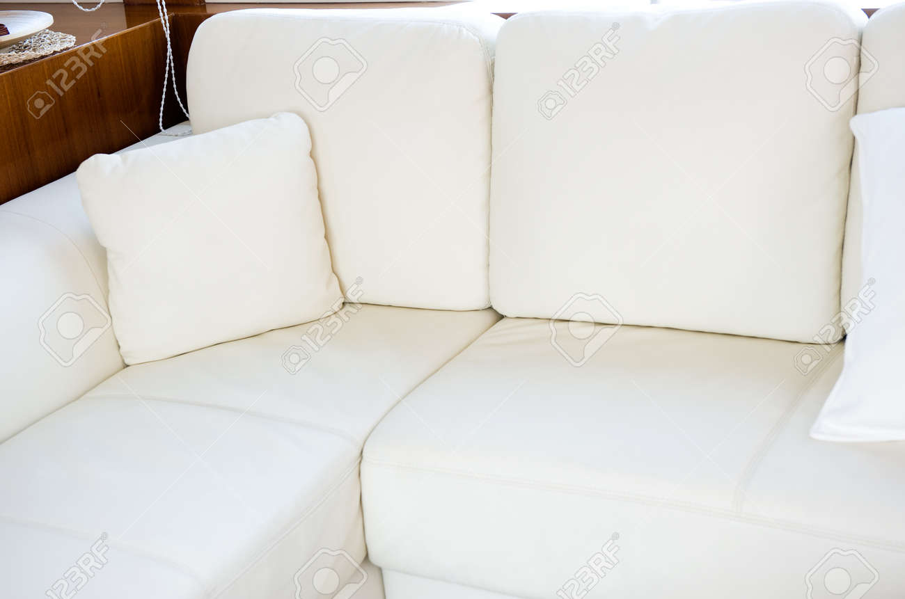 Comfortable corner in family room, with many white pillows. Stock Photo - 13883562