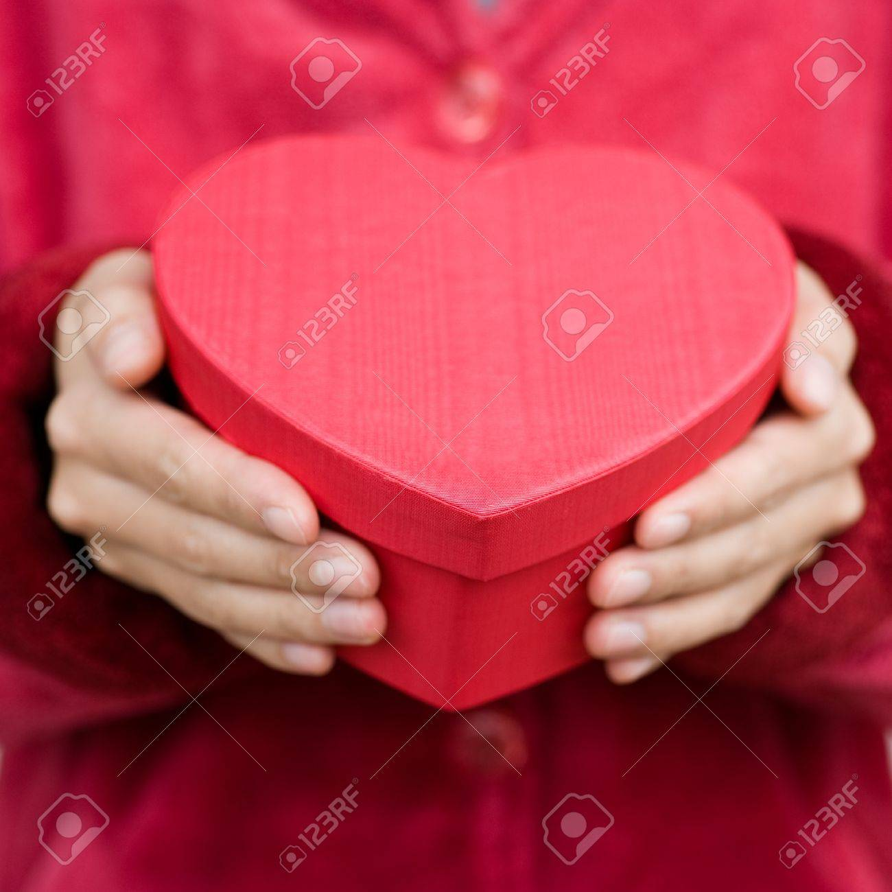 Heart Shaped Gift Box In Hands. Stock Photo, Picture And Royalty ...