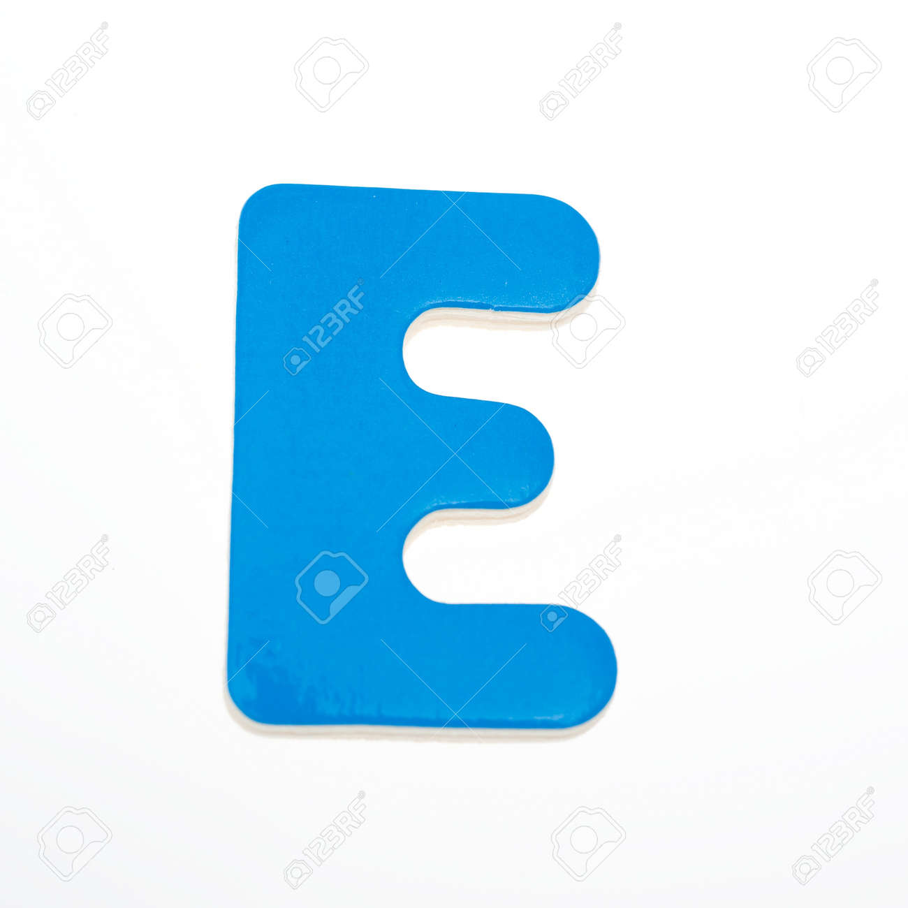 wooden toy letter E isolated on white background. Stock Photo - 14588238