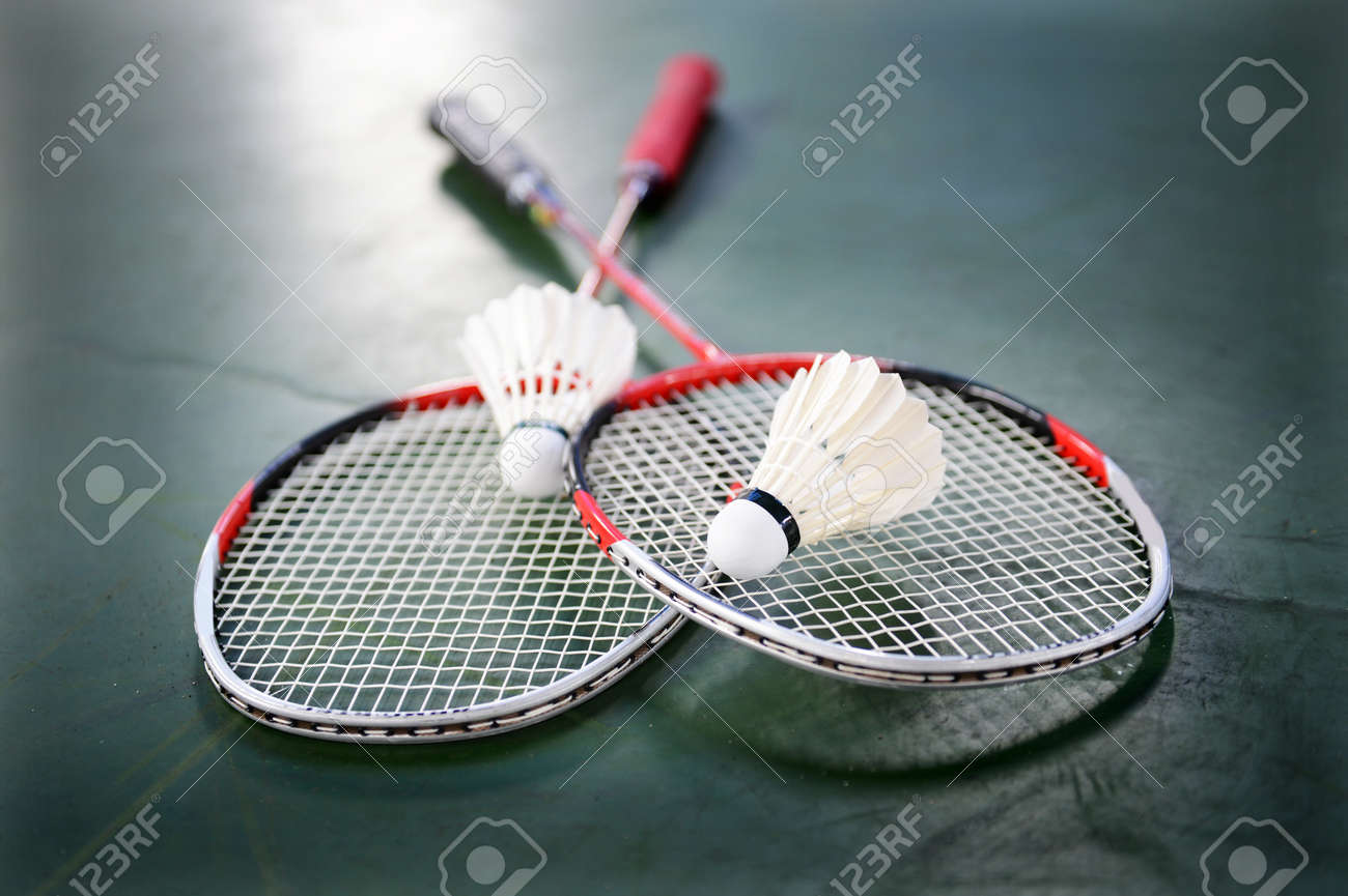 two shuttlecocks and badminton racket stock photo picture and