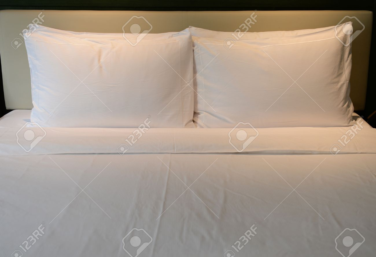 White beautiful pillows on hotel bed. Stock Photo - 15136549