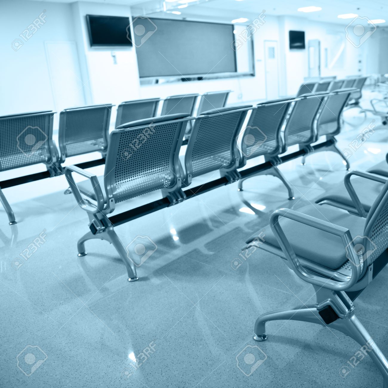 Empty chair in room - Hospital Waiting Room With Empty Chairs Stock Photo 17828283