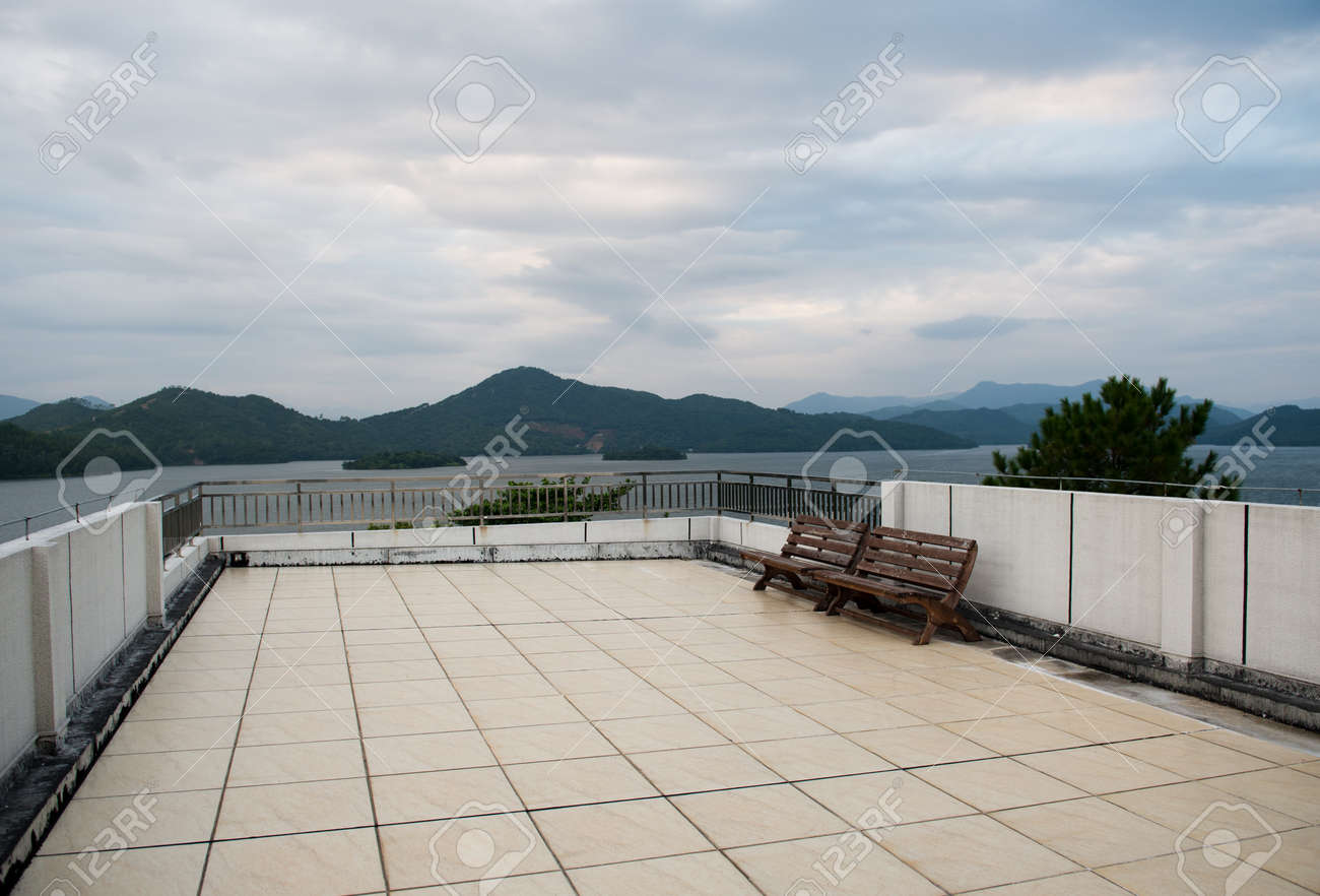 Apartment Building Roof apartment building roof top terrace exterior with bench. stock