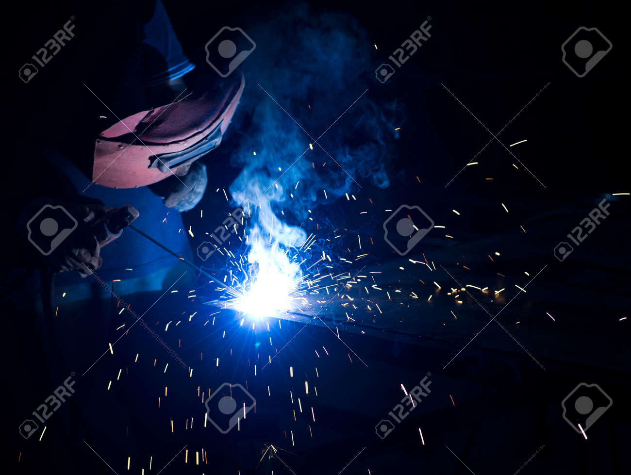 worker welding metal with sparks. Stock Photo - 19609996