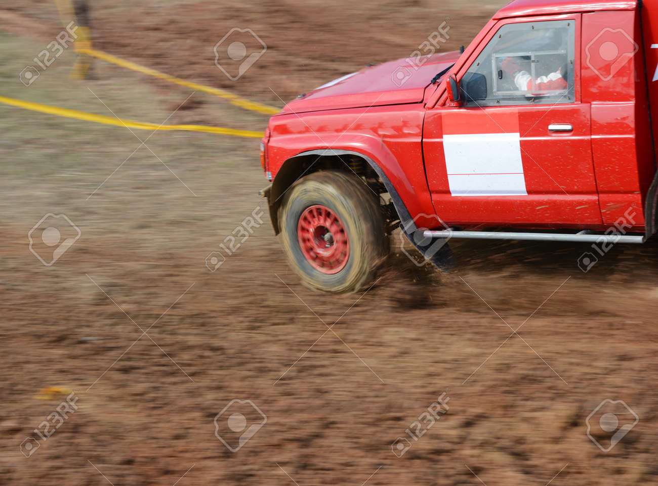 Driver competing in an off-road 4x4 competition. Stock Photo - 20027668