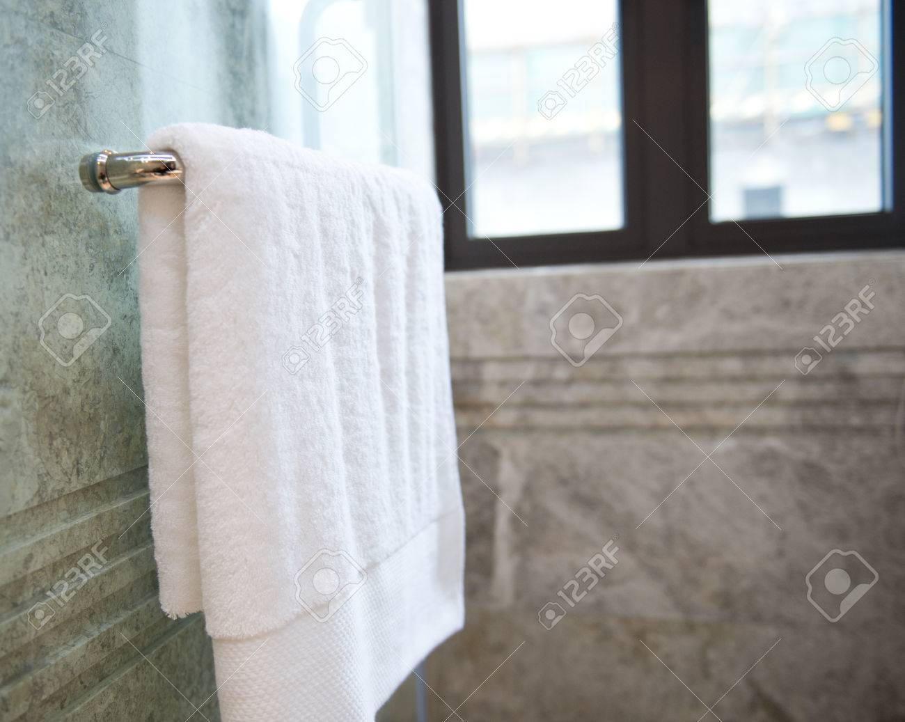 Clean White Towels In Bathroom Prepared To Use. Stock Photo   23087671