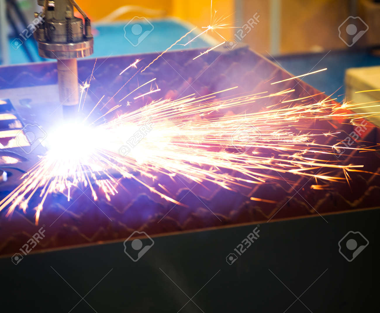 Industrial laser cutter with sparks. Stock Photo - 23534260